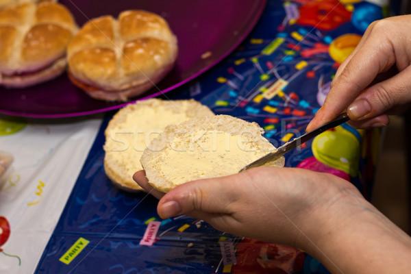 Kobieta masło chleba urodziny przekąska strony Zdjęcia stock © BigKnell
