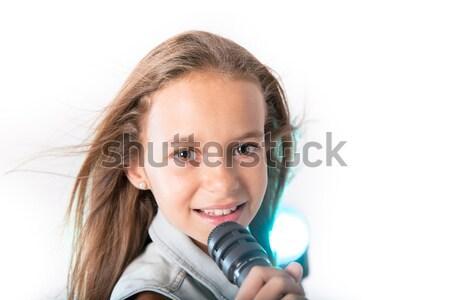 Młoda dziewczyna śpiewu mikrofon denim kurtka Zdjęcia stock © BigKnell