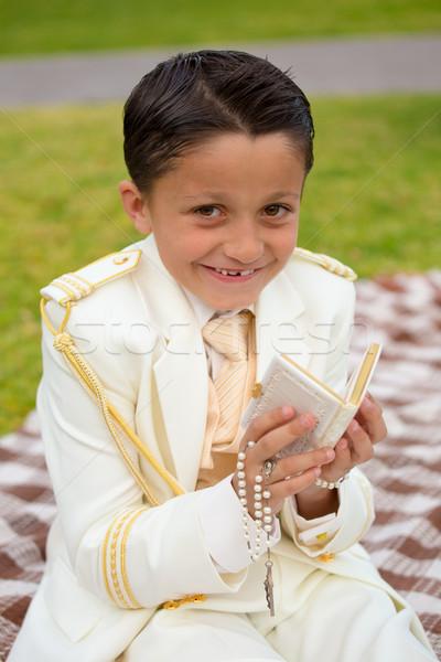 Fiatal elsőáldozás fiú mosolyog ima könyv Stock fotó © BigKnell