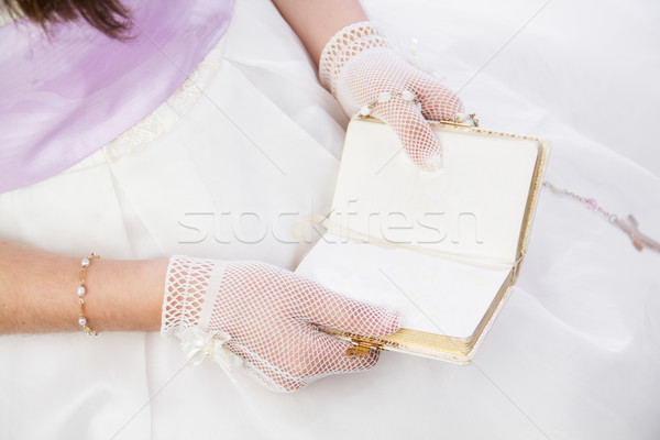 Stock photo: Young girl reading blank prayer book