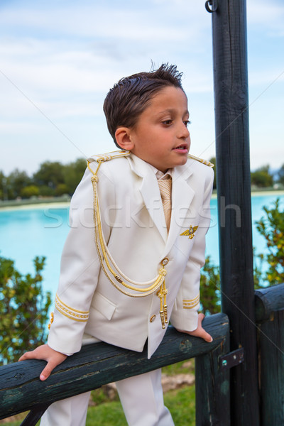 Young First Communion boy leaning on a wooden fence Stock photo © BigKnell