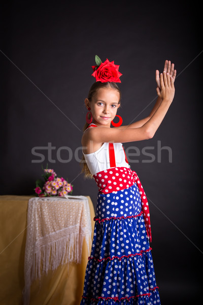 Young girl in flamenco outfit clapping hands Stock photo © BigKnell