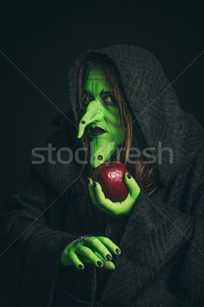 Evil witch with a rotten apple and a spider on her hands Stock photo © BigKnell
