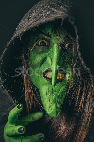 Evil witch casting a curse under her hood Stock photo © BigKnell