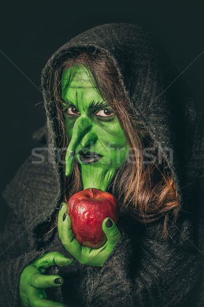 Angry witch with a rotten apple Stock photo © BigKnell