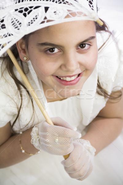 Fiatal lány esernyő elsőáldozás tart ünnepel első Stock fotó © BigKnell