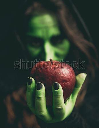 Rotten apple on a witch hand Stock photo © BigKnell