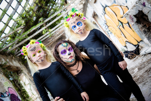 Woman and twin girls with sugar skull makeup Stock photo © BigKnell