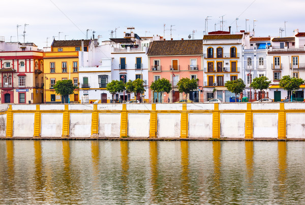 Houses Stores Restaurants Cityscape River Guadalquivr Morning Se Stock photo © billperry