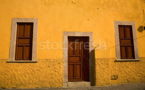 Yellow Adobe House Brown Doors Morelia Mexico Stock photo © billperry