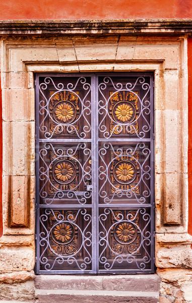 Golden Decorated Metal Brown Wooden Door San Miguel Mexico Stock photo © billperry