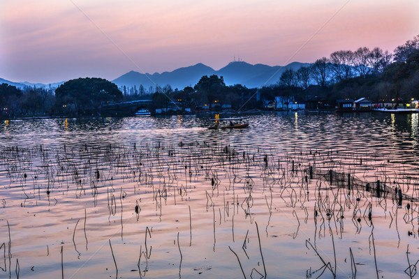 Barcos reflexión puesta de sol oeste lago naranja Foto stock © billperry
