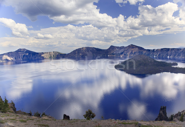 Wizard Island Crater Lake Reflection Clouds Blue Sky Oregon Stock photo © billperry