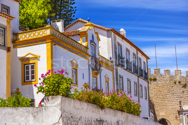 White Yellow Building 11th Century Castle Wall  Obidos Portugal Stock photo © billperry