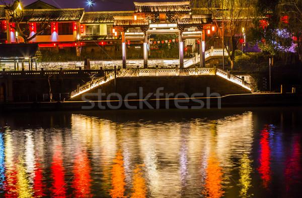 Chinese Gate Grand Canal Buildings NIght Reflection Hangzhou Zhe Stock photo © billperry