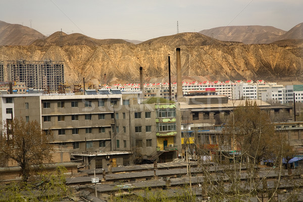Chinese Factory with Chimneys Apartments Gansu Province, Qinghai Stock photo © billperry