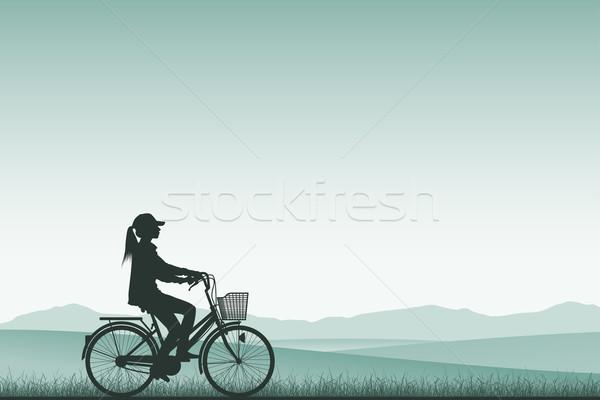 Meisje fiets silhouet weide landschap achtergrond Stockfoto © Binkski