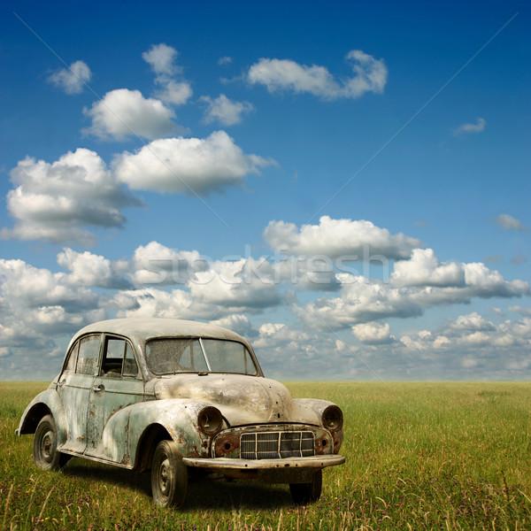 Stary samochód opuszczony trawy krajobraz Zdjęcia stock © Binkski