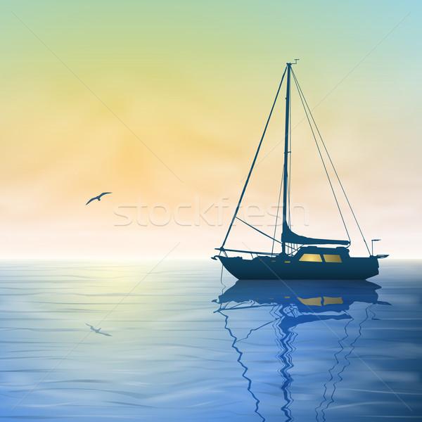 Zeilen boot mistig zonsondergang reflectie water Stockfoto © Binkski