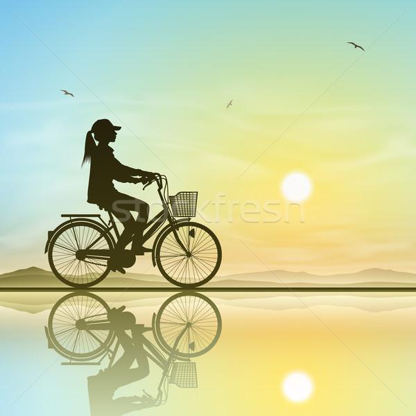 Meisje fiets silhouet zonsondergang zonsopgang vrouwen Stockfoto © Binkski