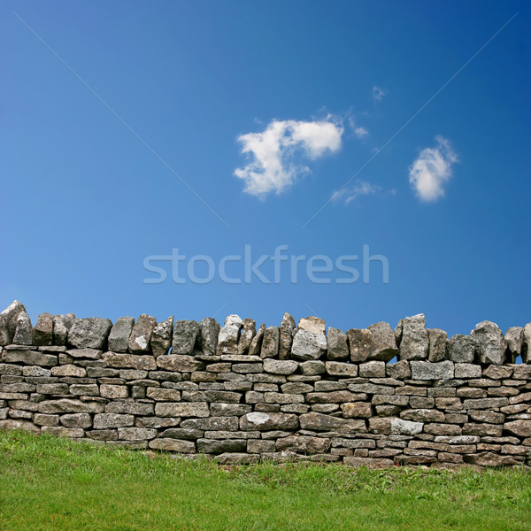 Muro de piedra cielo azul nubes pared paisaje Foto stock © Binkski