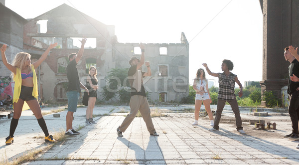 Energetic young hip hop street dancer Stock photo © blanaru