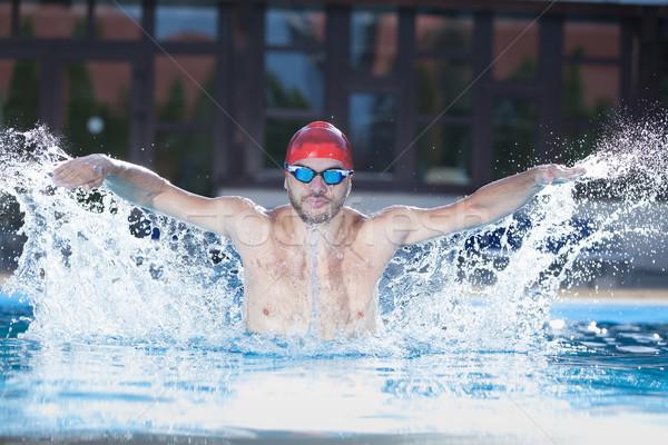 Nuotatore piscina giovani nuoto stile Foto d'archivio © blanaru