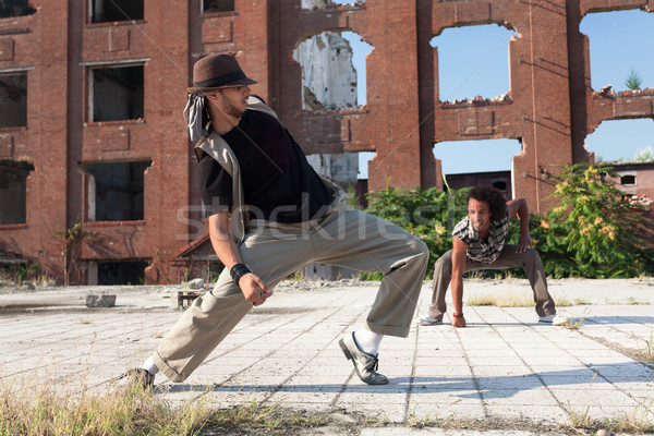 Two young men street dancing in a city square Stock photo © blanaru