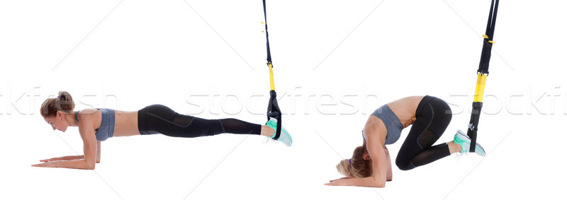 TRX crunch on elbows Stock photo © blanaru