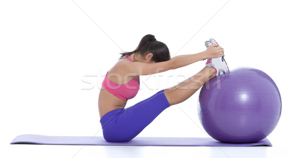 Spine stretch toe touch on a swiss ball Stock photo © blanaru