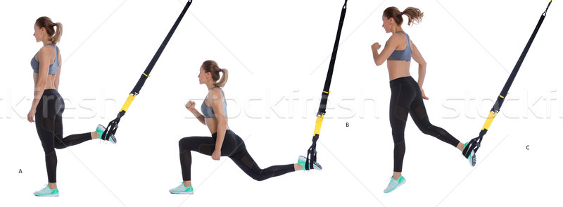 TRX lunge exercise with hop Stock photo © blanaru