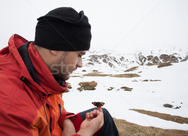 Man on mountain with a butterfly Stock photo © blanaru