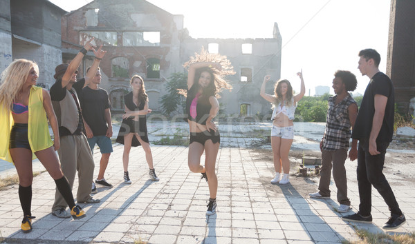 Energetic young hip hop street dancers Stock photo © blanaru