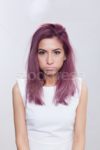 Disappointed young woman Stock photo © blanaru