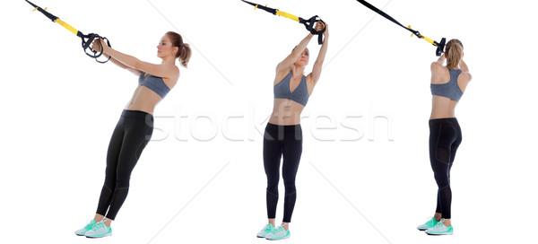 Törzs rotáció sportos nő előad testmozgás Stock fotó © blanaru