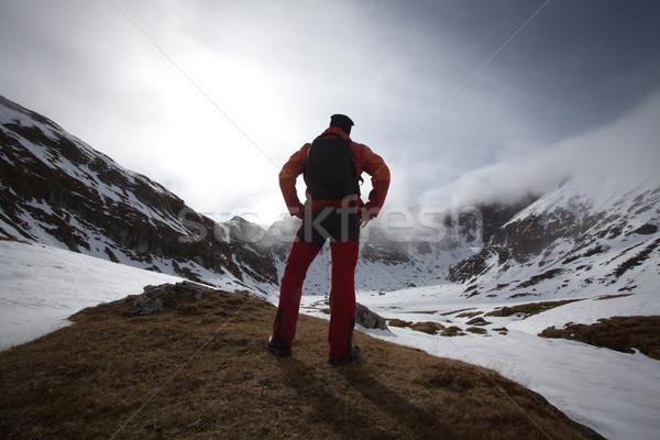 Man on mountain admiring Stock photo © blanaru