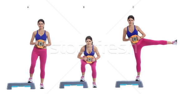 Sumo Squat and Leg Raise with disc weight on a step Stock photo © blanaru