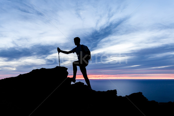 Man hiking silhouette in mountains, ocean and sunset inspiration Stock photo © blasbike