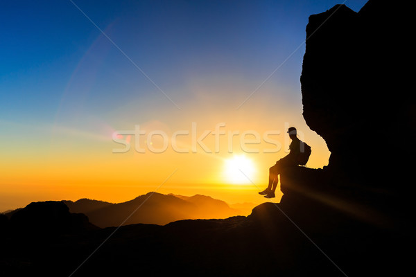 Man hiking silhouette in mountains sunset freedom Stock photo © blasbike