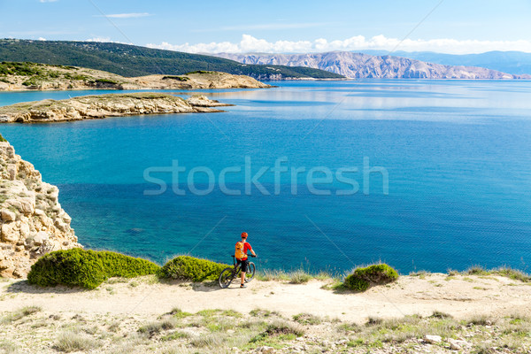 Mountain biker riding on bike at the sea Stock photo © blasbike