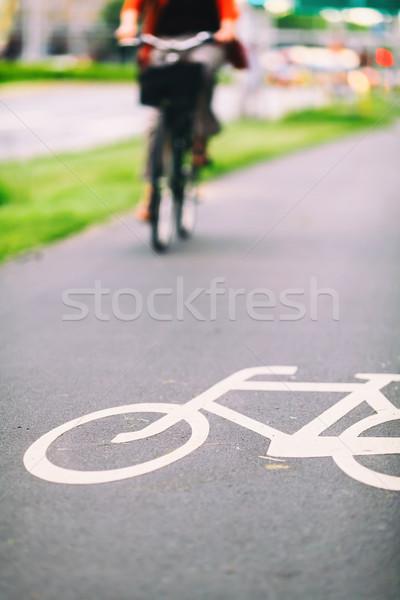 City bike sign on road colorful Stock photo © blasbike