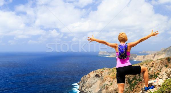 Happy trail runner woman winner reaching life goal success Stock photo © blasbike