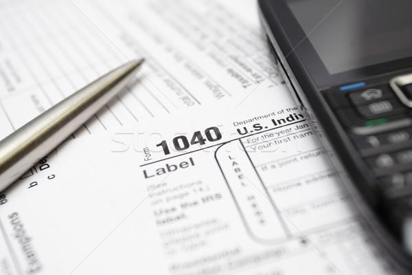 1040 налоговых возврат форме смартфон пер Сток-фото © blasbike