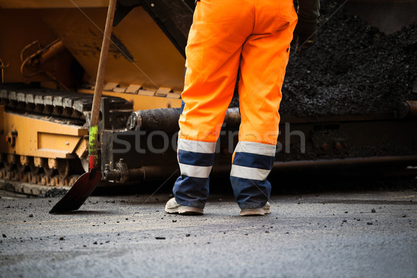 дорожное строительство работник лопатой новых асфальт дороги Сток-фото © blasbike