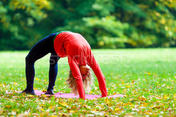 Stock photo: Young woman exercising yoga autumn