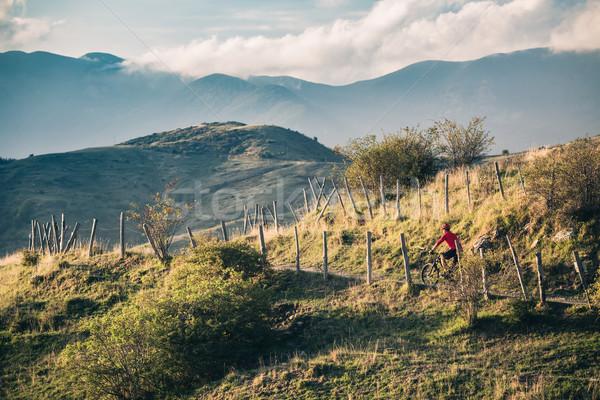 Mountain bike rider on single track trail in inspirational lands Stock photo © blasbike