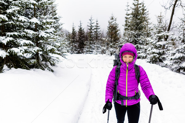 Happy woman walking in winter woods with backpack Stock photo © blasbike