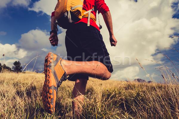 Hiker walking with backpack in beautiful landscape Stock photo © blasbike