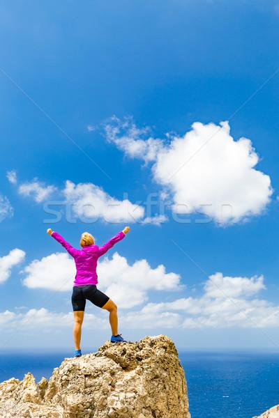 Happy trail runner winner reaching life goal success woman Stock photo © blasbike