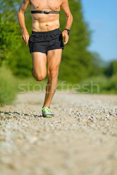 Man trail running on country road Stock photo © blasbike